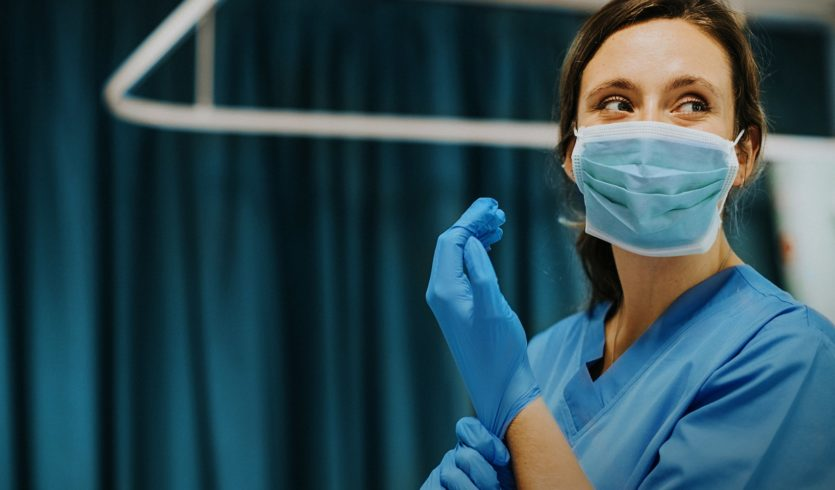 Female healthcare worker with PPE
